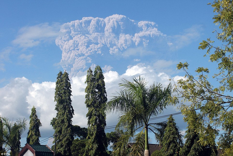 Safety concerns: Scores of farmers who work but do not live on the island were ordered to leave and not return until the volcano has finished erupting